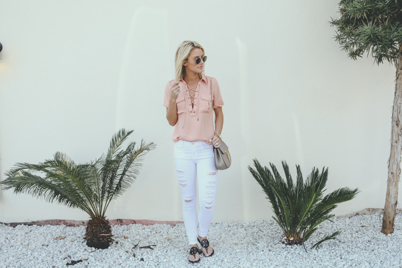pink lace up top and white jeans