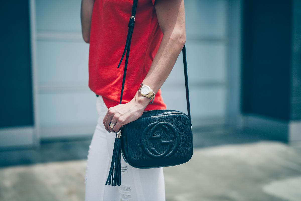 black gucci purse with tassel