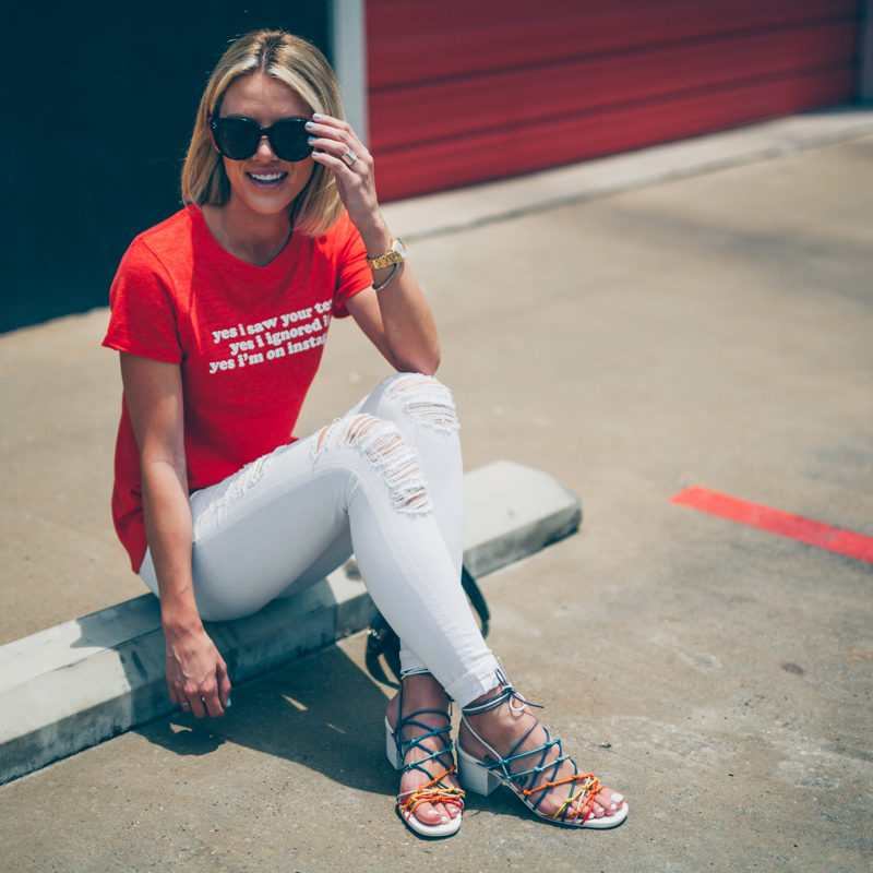 red tee and white jeans outfit