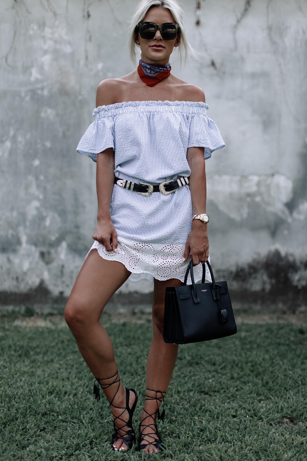 blue and white seersucker off the shoulder dress on blogger Sage Coralli