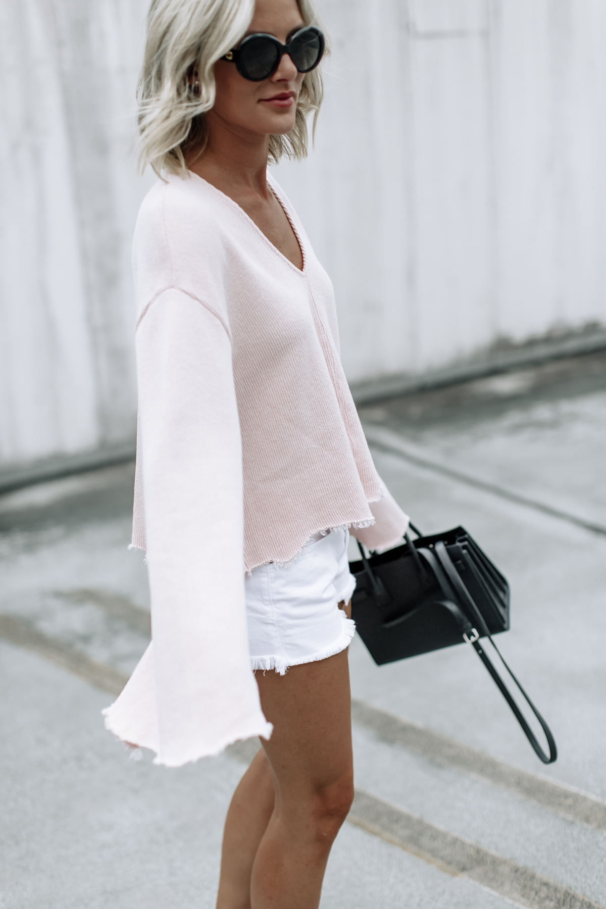 cute pink flare top on So Sage