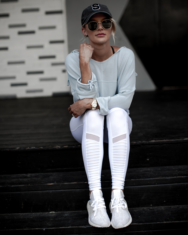 cute athleisure wear in white leggings and grey crop hoodie