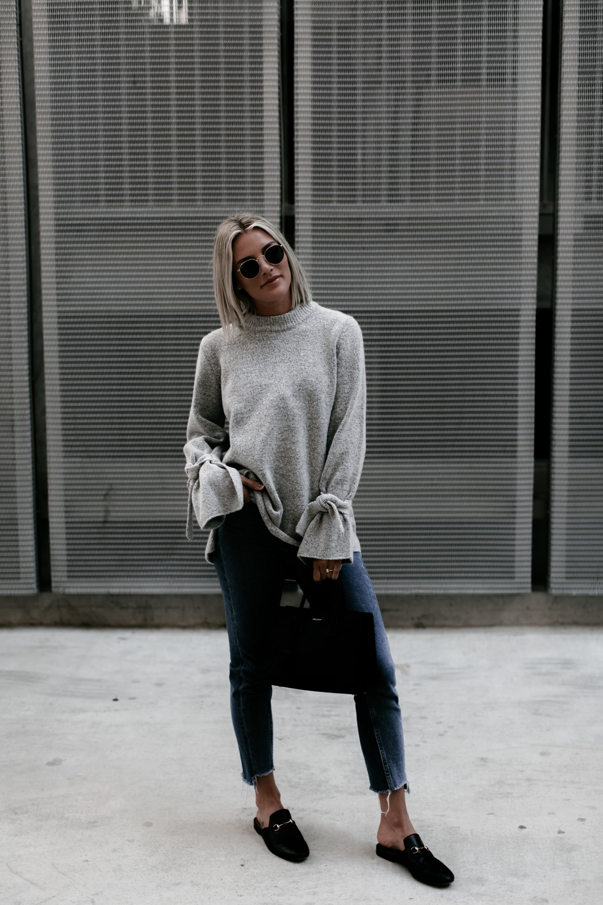 a cute and cozy grey sweater with tie sleeves on blogger So Sage