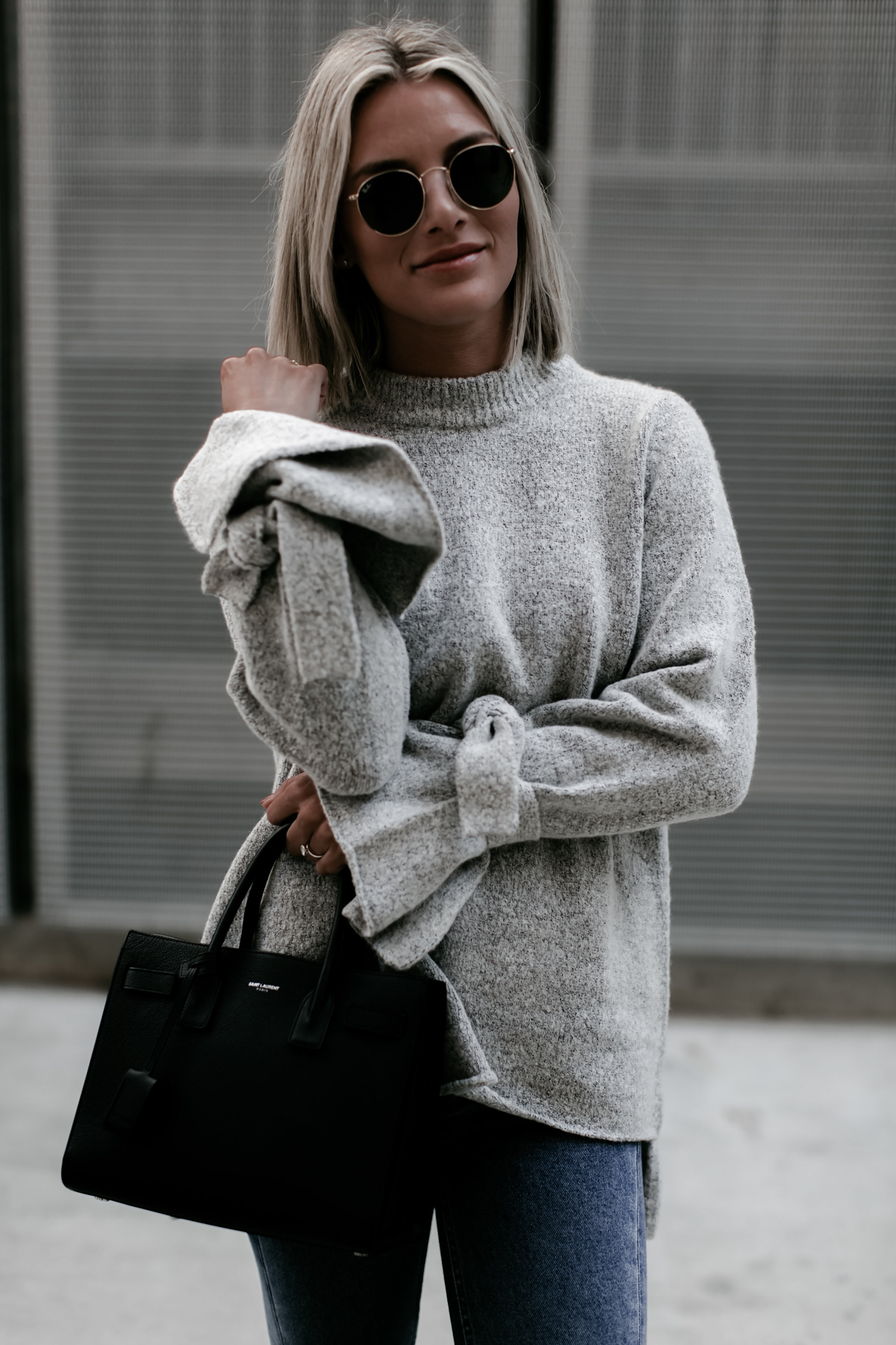 blogger So Sage wearing a grey tie sleeve sweater