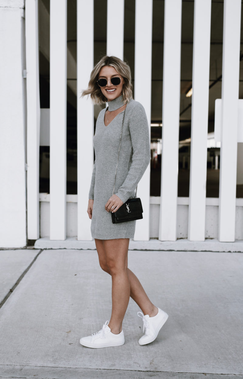 So Sage Blog in Fall outfit wearing grey sweater dress and white sneakers