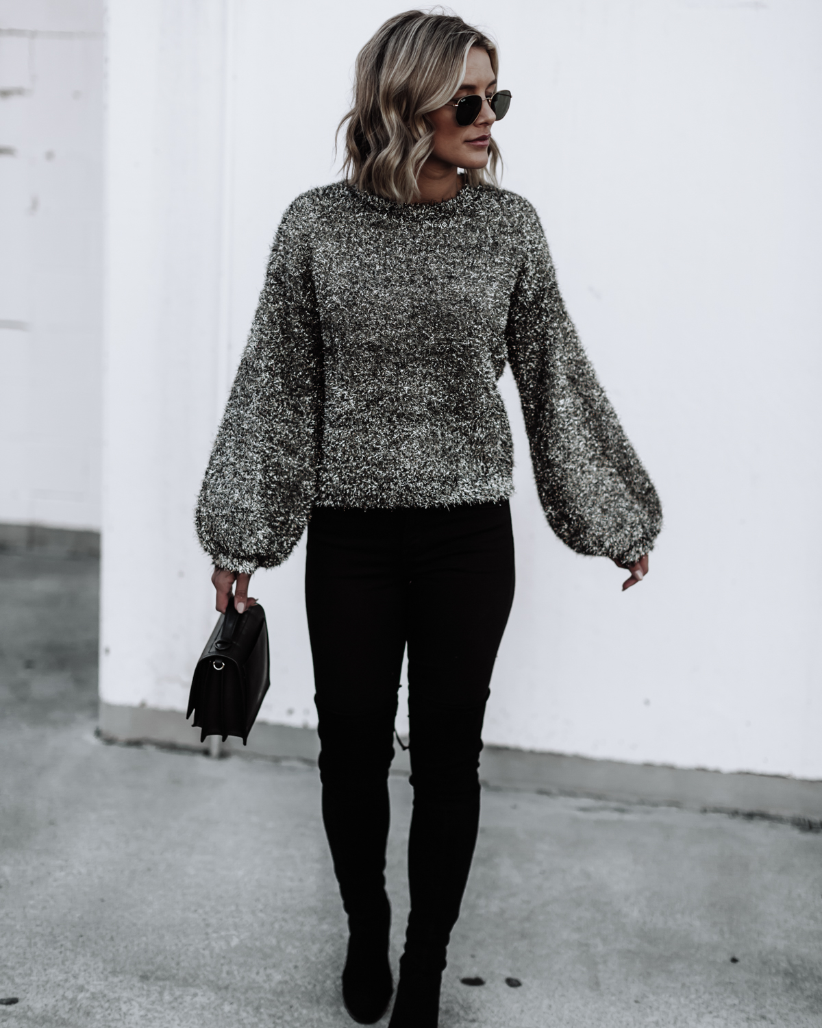 blogger So Sage wearing a fluffy sweater and jeans with OTK boots