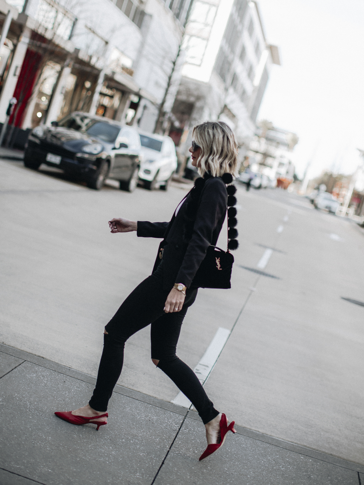 Sage Coralli wearing a pop of red slingback heels by Sigerson Morrison