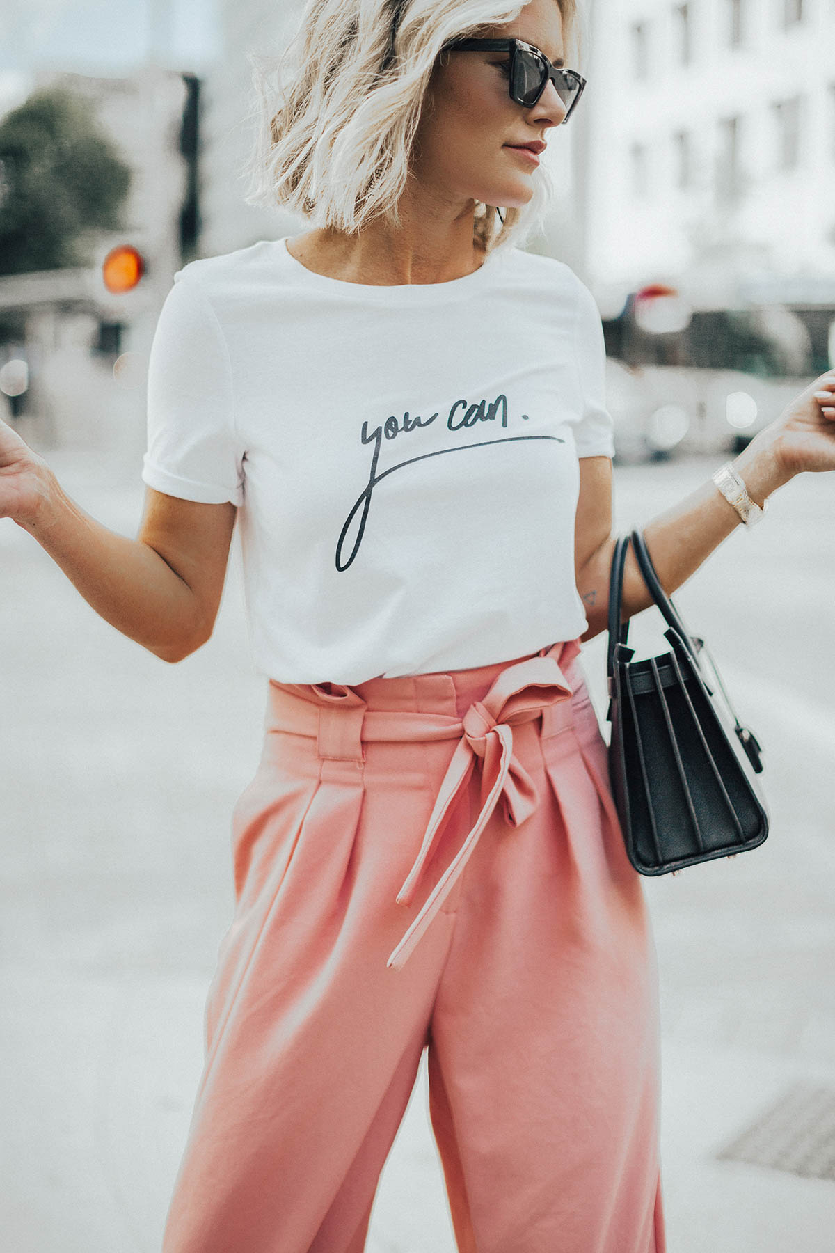 Sage Coralli wearing cute pink pants for Summer