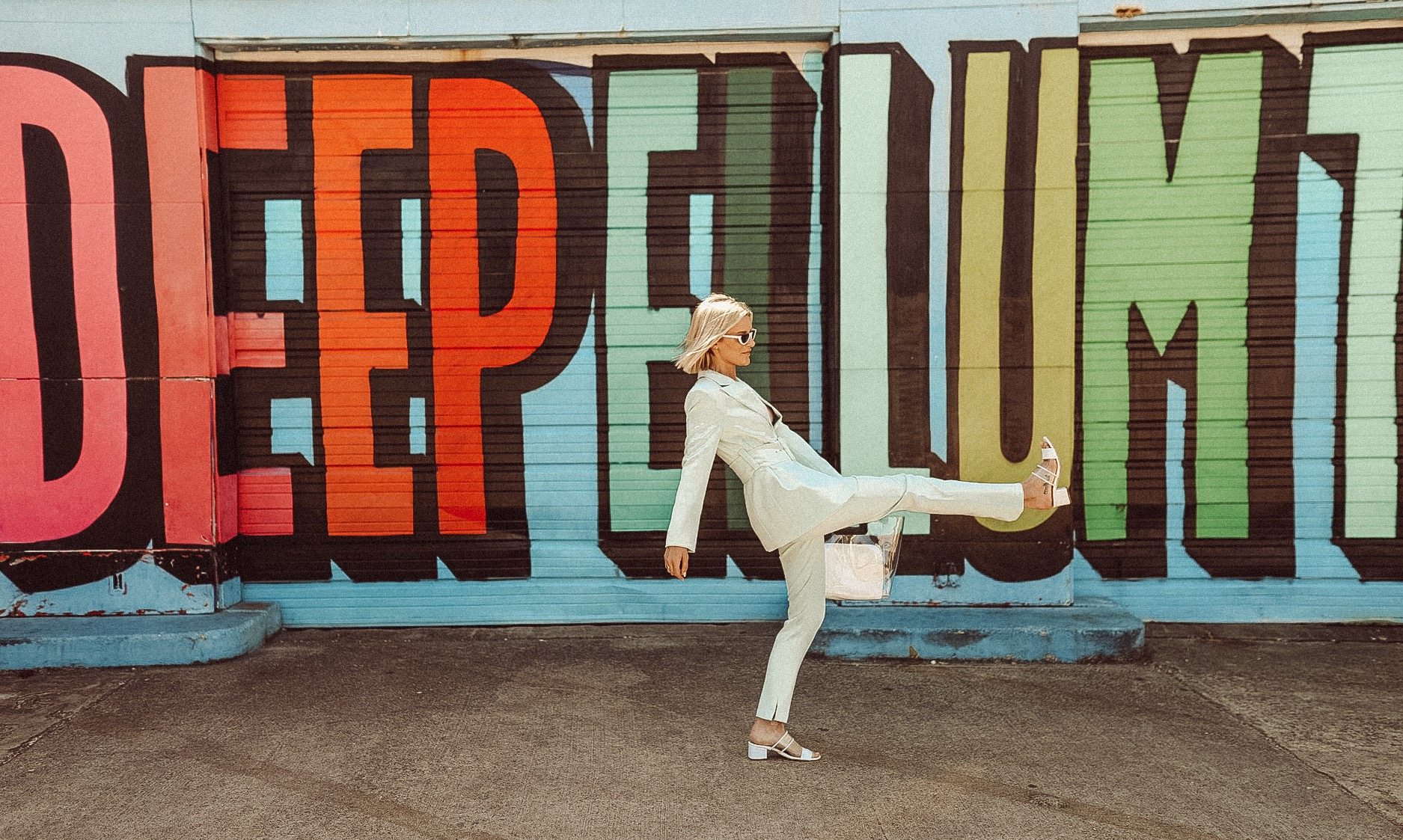 Dallas blogger So Sage in front of Deep Ellum colorful mural