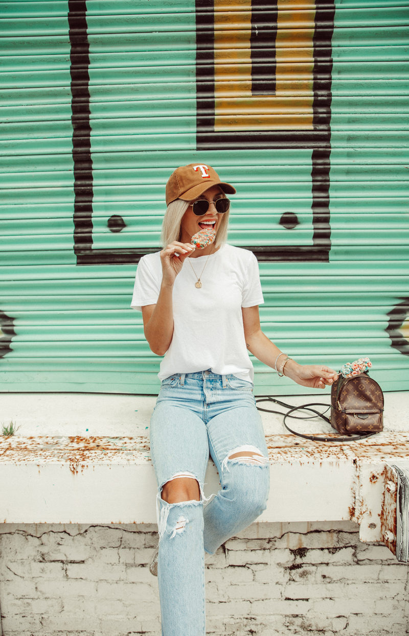 Blogger So Sage wearing a casual summer outfit with a baseball cap