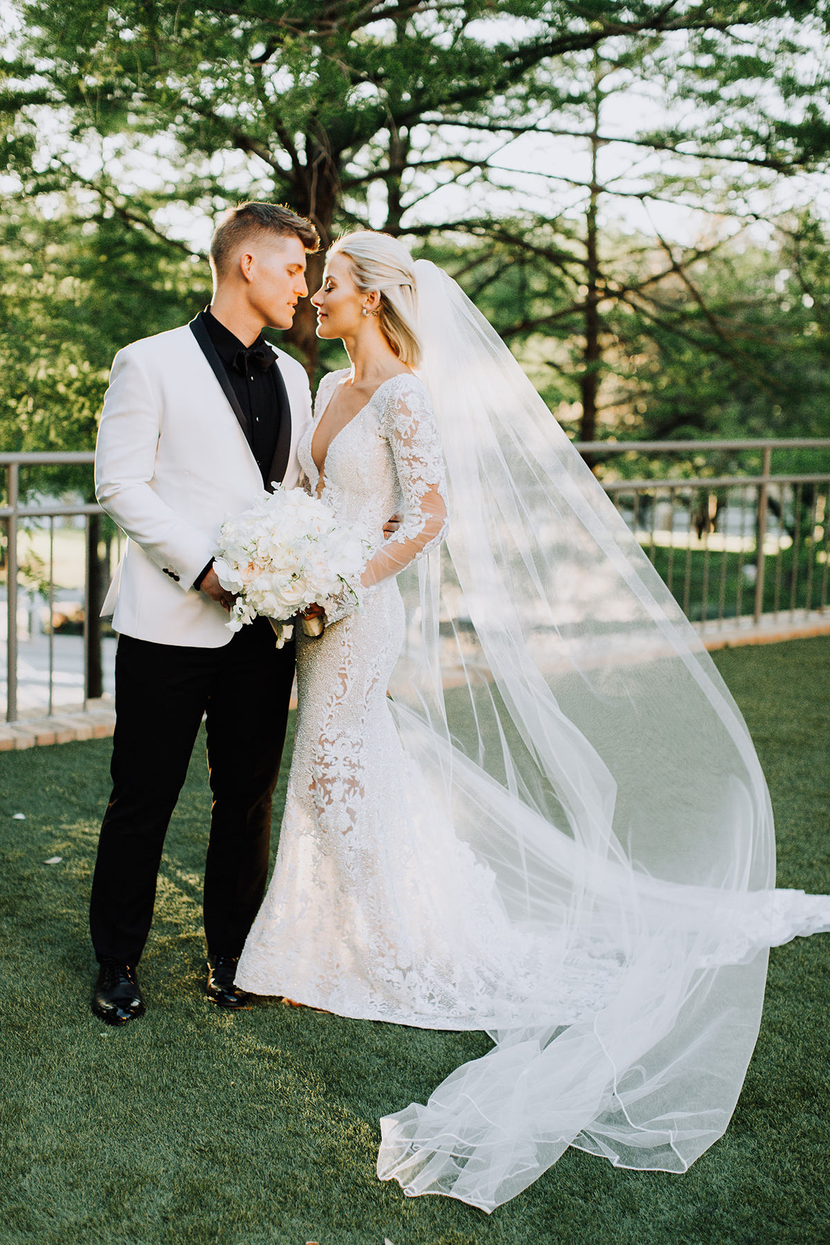 long sleeve wedding dress with low back and long veil from bridal boutique