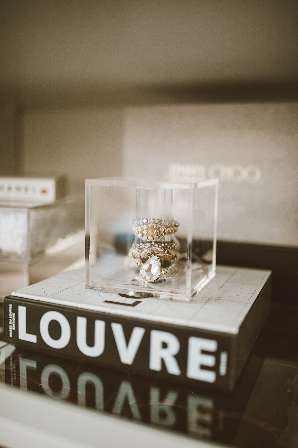 lucite jewelry bracelet holder and organizer from the container store in So Sage Blog's cloffice space
