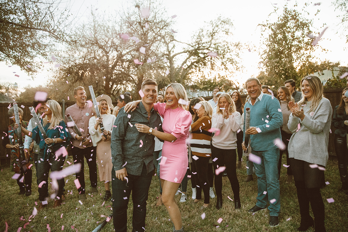 gender reveal for baby girl with family