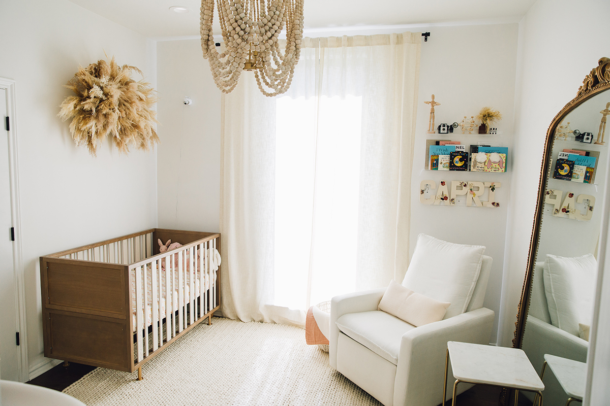 baby girl nursery inspiration with gold accents and neutral furniture